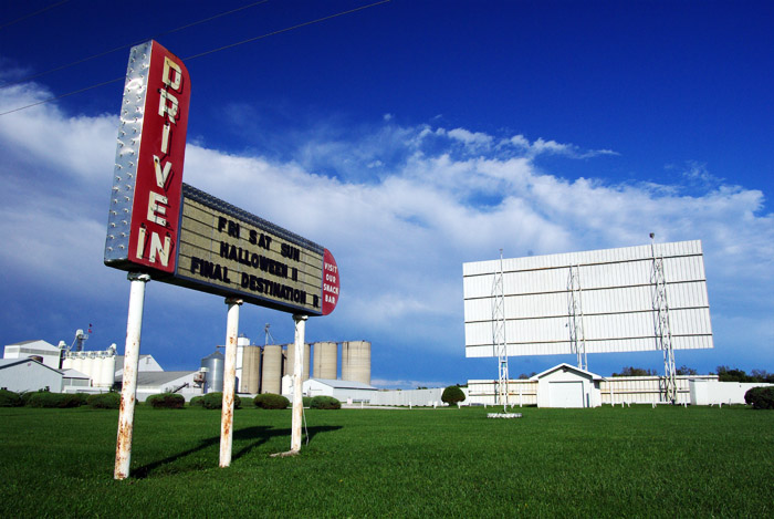 I love this - a drive-in theater, still in operation, right next to a bunch of silos.