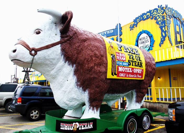 """Tiny"" or ""Moo-Moo"" advertising the Big Texan's famous challenge"