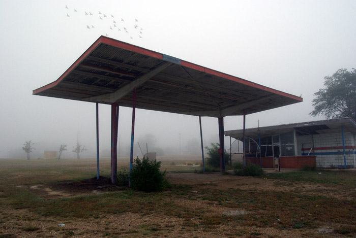 birds over an abandoned gas station in McLean, TX