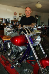 Leroy Edwards with one of the custom motorcycles he's building