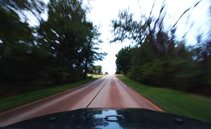 1930s Portland concrete under the wheels as westarn Oklahoma whizzes past the windshield