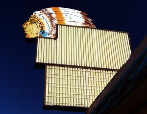 Indian head neon sign on empty building